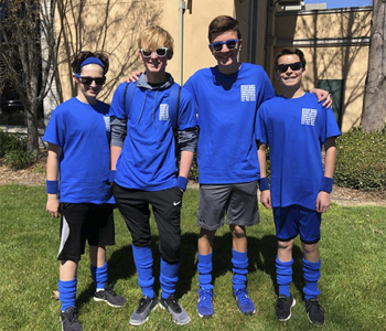 Amazing Race Team of 4 teenage boys in matching blue tshirts